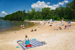 Sandy Beach at a Community Park. Franklin County, VA – May 29th: People enjoy a sandy beach on a beautiful summer's day at the Smith Mountain Lake Community Stock Photo