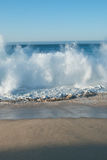Sandy beach crashing wave Royalty Free Stock Images