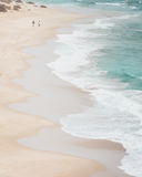 Sandy beach with crashing waves from above. Beach on the great ocean road in australia. aerial view over the white sand and crashing waves of ocean Stock Image