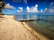 Sandy beach at the cyan sea. Maldives. Royalty Free Stock Photo