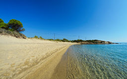 Sandy beach. Deep Carydi, Sithonia, Greece, and electric supply line in background, horizontal orientation Royalty Free Stock Photography