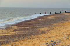 The sandy beach. A deserted sandy beach at Southwold, littered with small pebbles royalty free stock photography