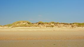 Sandy beach and dunes on the North sea Opal coast. Sand beach and dunes on the North sea Opal coast under a clear blue sky, Nord PAs De calais, France stock photography