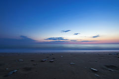 Sandy beach at the dusk, Peloponnese - Greece. Royalty Free Stock Image