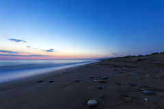 Sandy beach at the dusk, Peloponnese - Greece. Royalty Free Stock Images