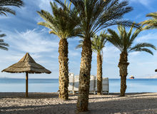 Sandy beach of Eilat - famous resort and tourist city in Israel Stock Photos