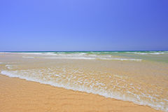Sandy beach at Faro Stock Photography