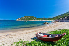 Sandy Beach with fisher boat Stock Image