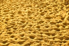 Sandy beach with footprints Royalty Free Stock Photos
