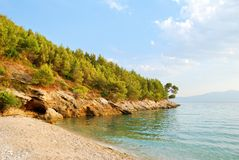 Sandy Beach and Green Hill. With Blue Sea Royalty Free Stock Image
