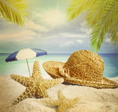 Sandy beach, hat and starfish in summer sand Royalty Free Stock Images