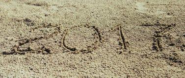 Sandy Beach Het concept van het nieuwjaar Stock Afbeeldingen