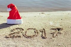 Sandy Beach Het concept van het nieuwjaar Stock Afbeelding