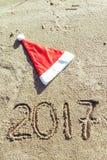 Sandy Beach Het concept van het nieuwjaar Stock Foto's