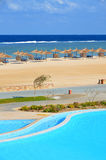 Sandy beach at hotel in Marsa Alam - Egypt. Beautiful beach and swimmig pool at hotel in Egypt Marsa Alam Stock Photo