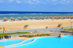 Sandy beach at hotel in Marsa Alam - Egypt. Beautiful beach and swimmig pool at hotel in Egypt Marsa Alam Royalty Free Stock Image
