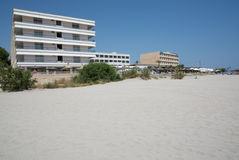 Sandy beach and hotels Stock Photography