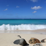 Sandy beach on an island and blue sea Stock Image