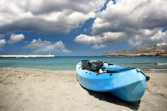 Sandy beach and kayak Stock Photos