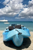 Sandy beach and kayak Stock Photography
