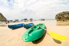 Sandy beach with kayaks amd speedboats in Ang Thong near Ko Samu Thailand. Sandy beach with kayaks amd speedboats in Ang Thong near Ko Samui - Beautiful tropical Stock Photo