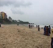 The sandy beach at Kunoor with locals and tourists. And strong sea waves Stock Images