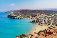 Sandy beach and lagoon with clear blue water at Crete island near Sitia town, Greece. Royalty Free Stock Photos