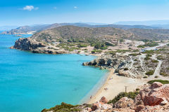 Sandy beach and lagoon with clear blue water at Crete island near Sitia town, Greece. Stock Photography