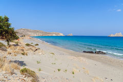 Sandy beach and lagoon with clear blue water at Crete island near Sitia town, Greece. Stock Images