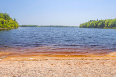 Sandy beach on Lake Stock Images