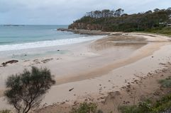 Sandy beach landscape with mild waves and no people. Nature background royalty free stock photo