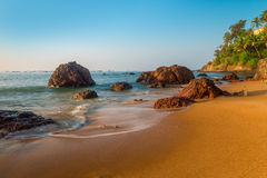 Sandy beach and large boulders Royalty Free Stock Image