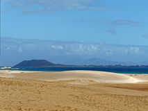 Sandy Beach. A large sandy beach. This is at Corralejo on Fuerteventura in the Canary Islands Royalty Free Stock Photography