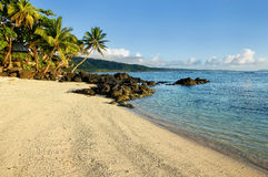 Sandy beach in Lavena village on Taveuni Island, Fiji Stock Images