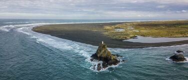 Sandy beach and lighthouse on the cliff aerial panorama