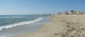 Sandy Beach Line in La Manga del Mar Menor. Sandy Beach Line Panorama - La Manga del Mar Menor, Cabo de Palos, Cartagena and San Javier, Murcia, Spain, Europe Royalty Free Stock Photo