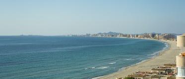 Sandy Beach Line in La Manga del Mar Menor. Sandy Beach Line Panorama - La Manga del Mar Menor, Cabo de Palos, Cartagena and San Javier, Murcia, Spain, Europe Royalty Free Stock Photos