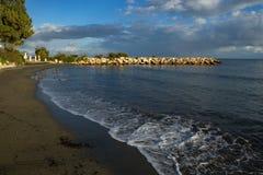 Sandy Beach and the long pier. Cyprus. Limassol surroundings Stock Photos