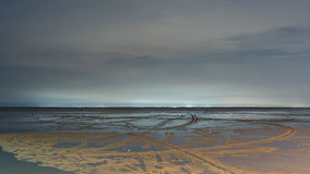 Sandy beach in low tide Stock Photography