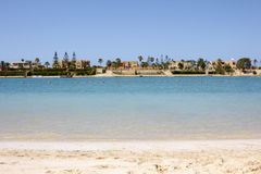 Sandy beach with luxury houses Royalty Free Stock Photos