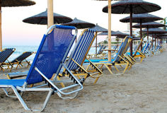 Sandy beach with many loungers and parasols. Photo of sandy beach with many loungers and parasols stock image