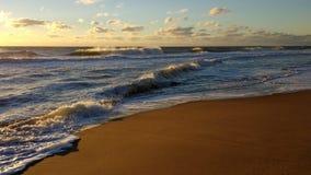 Sandy beach in Maryland at sunrise. Sunrise on a sandy beach in Maryland after the hurricane in September 2016 stock photos