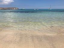 Sandy beach in Mellieha, Malta. Crystal clear water in Mellieha bay in Malta during a summer day Stock Photo
