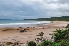 A sandy beach with moody sky, Northern Ireland royalty free stock image
