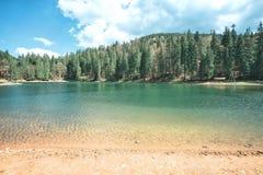 Sandy beach of mountain lake Stock Image