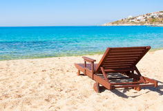 The sandy beach near the blue sea with sun beds. Mykonos Royalty Free Stock Image