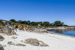 Sandy beach near Cypress Point. 17 Mile Drive, Big Sur, California, USA - July 1, 2012: The 17 Mile Drive is a scenic road through Pacific Grove and Pebble Stock Photo