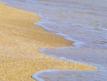 Sandy beach and the ocean on a sunny day. The sandy beach and the ocean on a sunny day Royalty Free Stock Photography