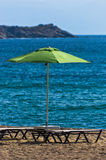 Sandy beach with one green sunshade at morning in Sithonia Stock Image