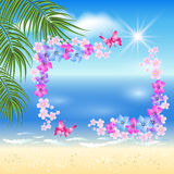 Sandy beach with palm and flowers Stock Photography